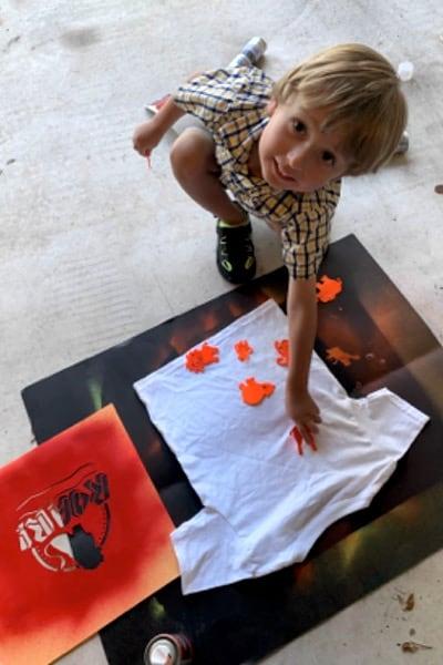 Preschooler helping make T-Shirt for VBS